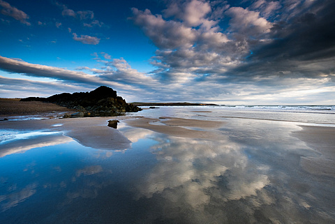 Tide pools at low tide at Porth Tyn Tywyn, Rhosneigr, West Anglesey, Wales, United Kingdom, Europe