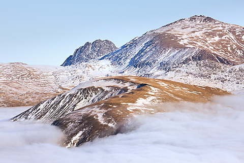 Tryfan and Glyder Fawr rise above an extensive temperature inversion in winter, Snowdonia, Wales, United Kingdom, Europe