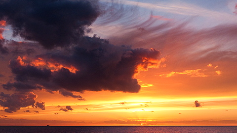 Sunset over the Irish Sea from Porth Nobla on the West coast of Anglesey, Wales, United Kingdom, Europe