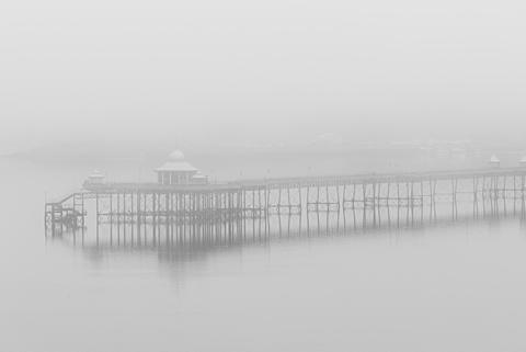 Bangor Victorian Pier in early morning sea fog over the Menai Strait, Bangor, Gwynedd, Wales, United Kingdom, Europe
