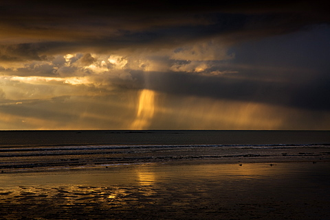 Cloudy and showery but sunshine from the West breaking through the clouds, Rhosneigr, West Coast of Anglesey, Wales, United Kingdom, Europe