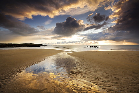 Beach pools and reflections at low tide on Tyn Tywyn beach, Rhosneigr, West Anglesey, Wales, United Kingdom, Europe
