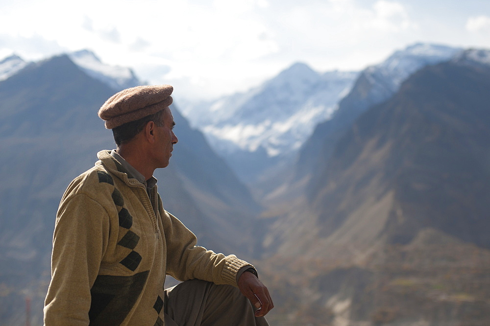 A man looks out over the Hunza Valley, Gilgit-Baltistan, Pakistan, Asia