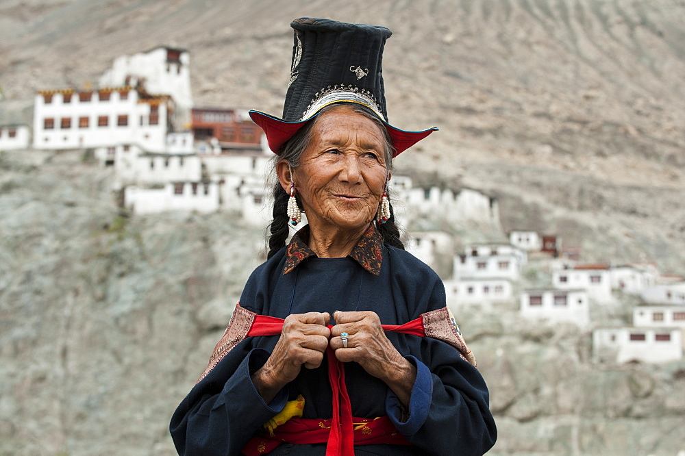 A Nubra woman wears traditional dress to attend a gathering at a local monastery in the Nubra Valley, Ladakh, India, Asia - 1225-112