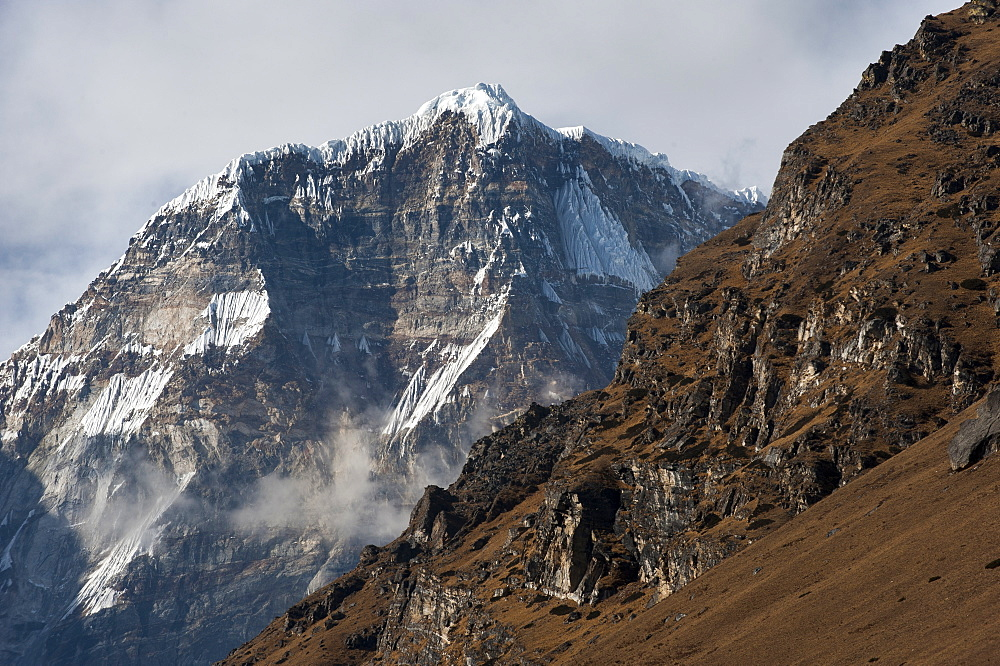 The looming face of Jomolhari, the third highest mountain in Bhutan at 7326m, seen from Jangothang, Bhutan, Himalayas, Asia
