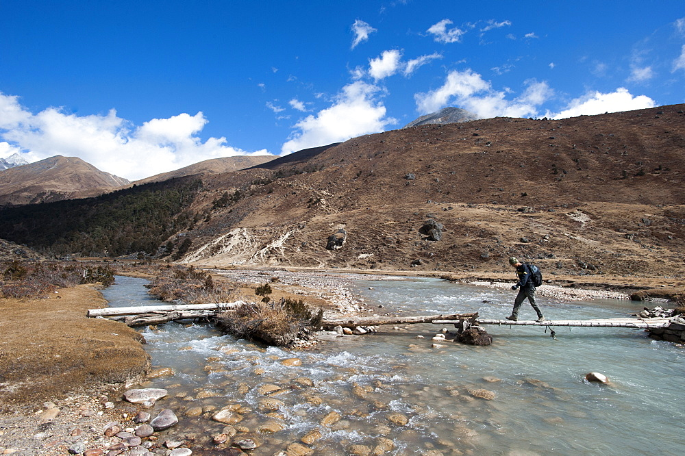 Trekking across a temporary bridge between Shomuthang and Robluthang on the Laya-Gasa trekking route, Gasa District, Bhutan, Asia