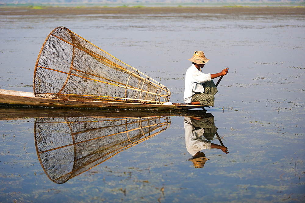 A basket fisherman on Inle Lake scans the still and shallow water for signs of life, Shan State, Myanmar (Burma), Asia - 1225-1179