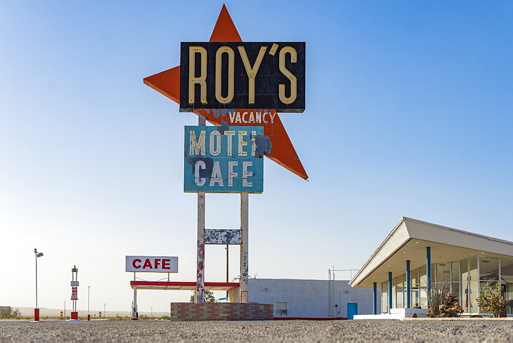 A classic retro looking sign for a gas station, motel and cafe along the historical Route 66 in the Mojave Desert, California, United States of America, North America