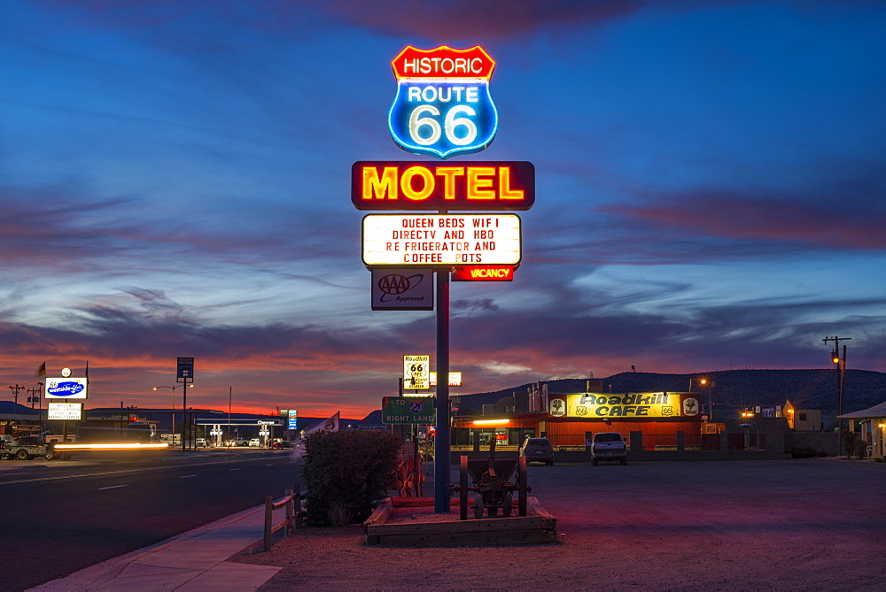 Historic Route 66 neon sign glowing at sunset, Seligman, Arizona, United States of America, North America