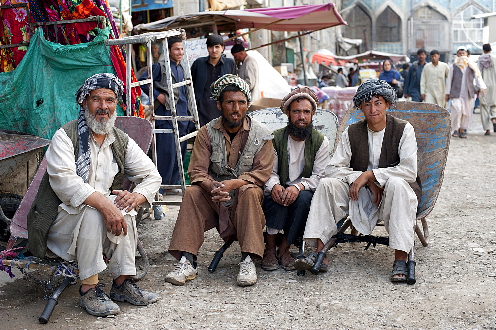 Taking a load off, a quick time out for these hard working Afghans in a bazaar in Kabul, Afghanistan, Asia - 1225-121