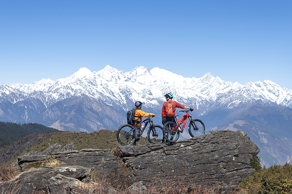 Mountain biking in the Himalayas with views of the Langtang mountain range in the distance, Nepal, Asia - 1225-1340