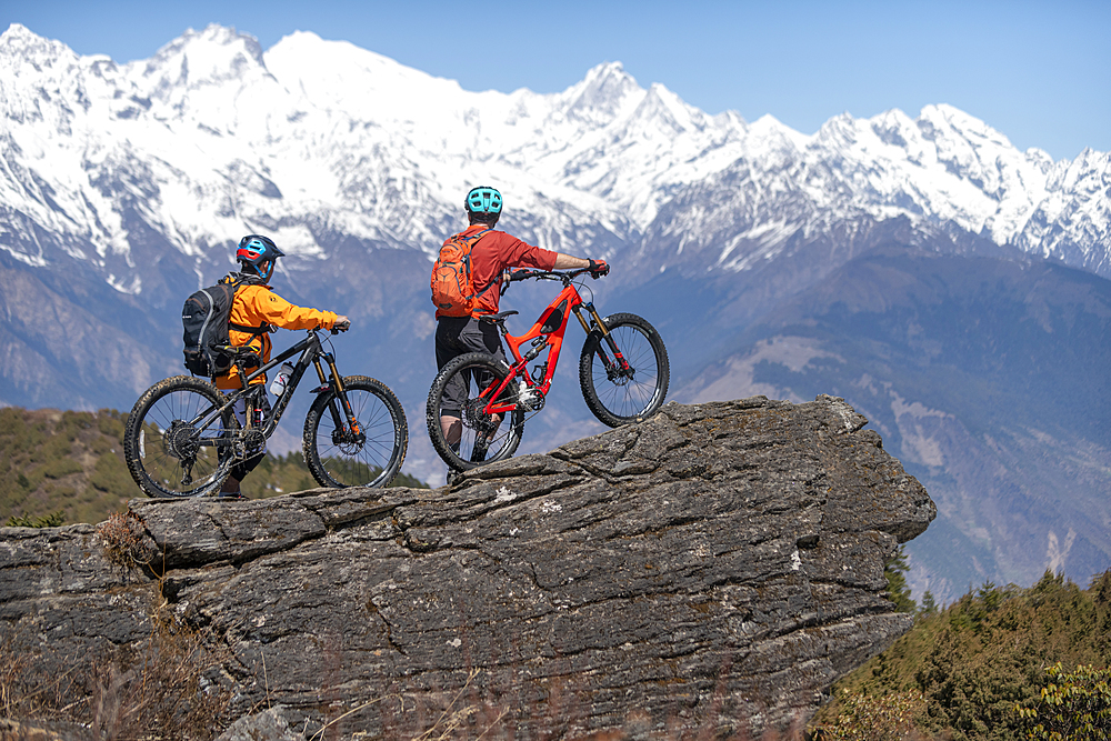 Mountain biking in the Himalayas with views of the Langtang mountain range in the distance, Nepal, Asia - 1225-1342