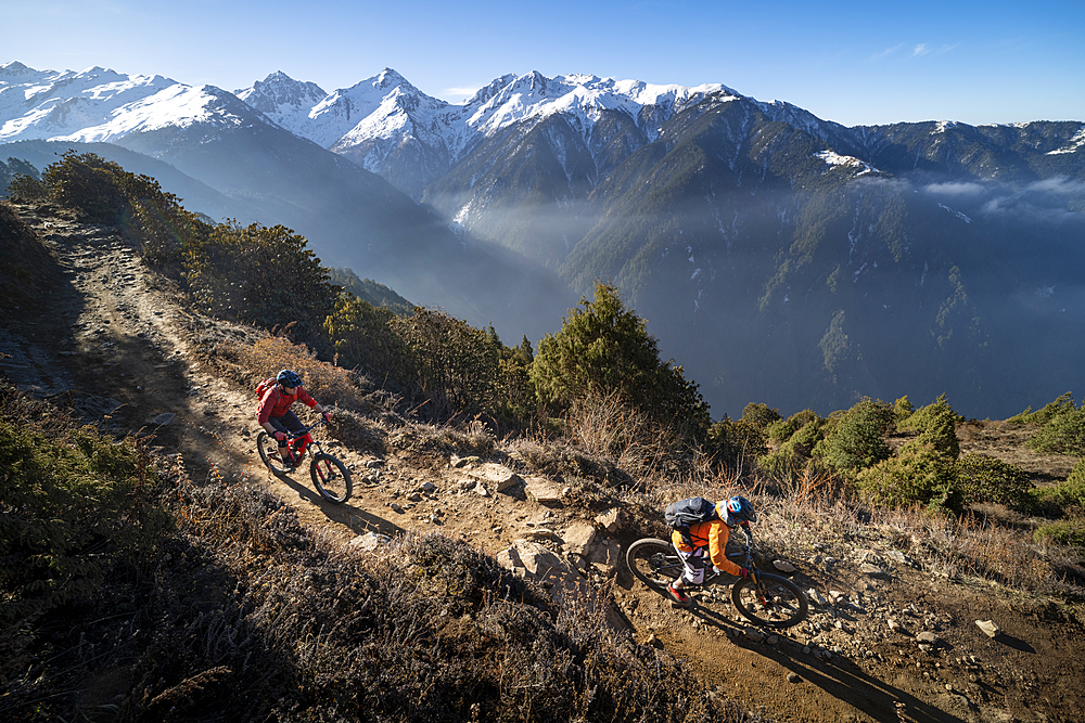 Mountain biking along a Enduro style single track trail in the Nepal Himalayas near the Langtang region, Nepal, Asia