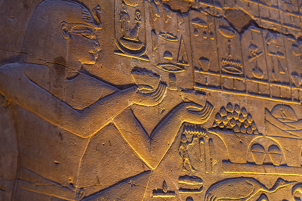 Hieroglyphics in the Temple of Luxor lit up at night, Luxor, Thebes, UNESCO World Heritage Site, Egypt, North Africa, Africa - 1225-1356