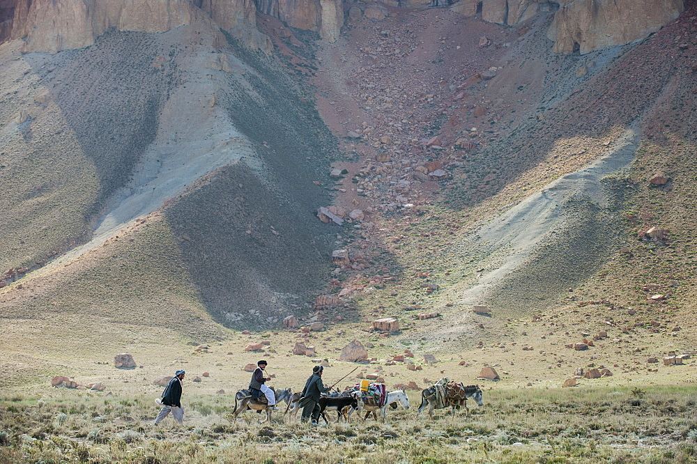 Donkeys and farmers make their way home near Band-e Amir, Afghanistan, Asia