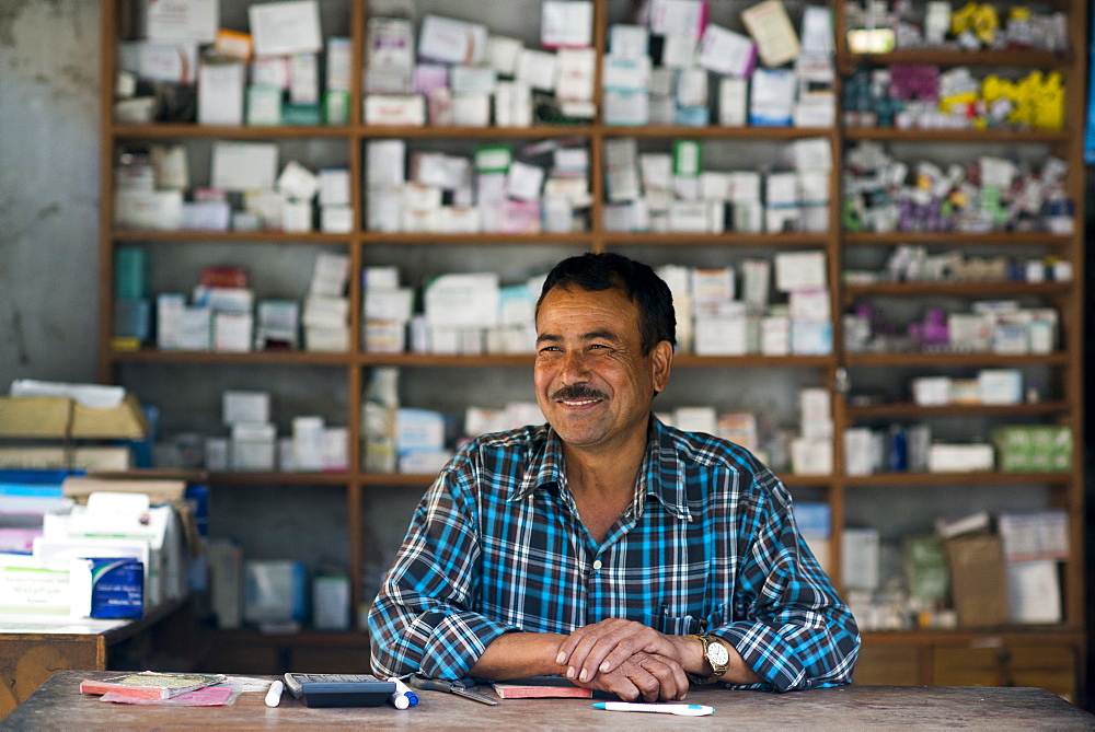 A man working in a dispensary next to a hospital in west Nepal, Asia