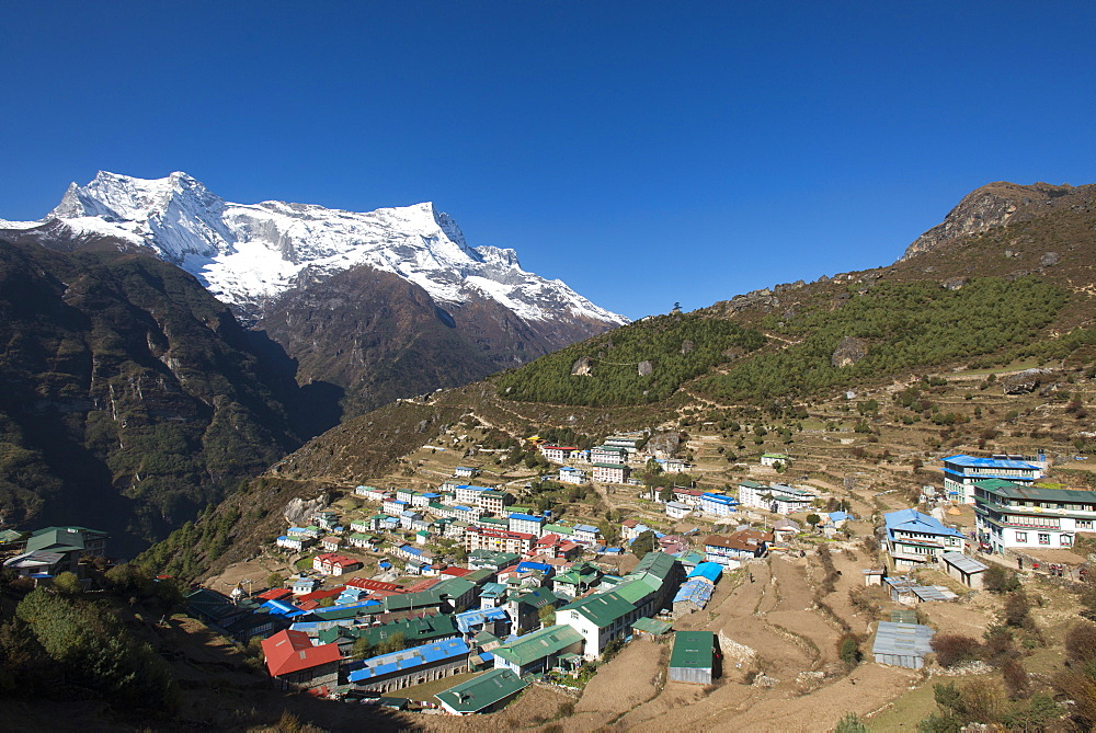 Namche, the main trading centre and tourist hub for the Khumbu (Everest region) with Kongde Ri peak, 6187m, in the background, Himalayas, Nepal, Asia