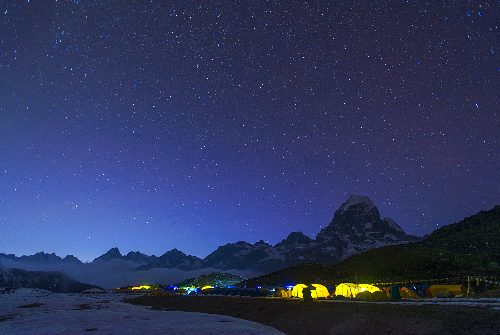 Ama Dablam base camp in the Everest region glows at twilight, Himalayas, Nepal, Asia
