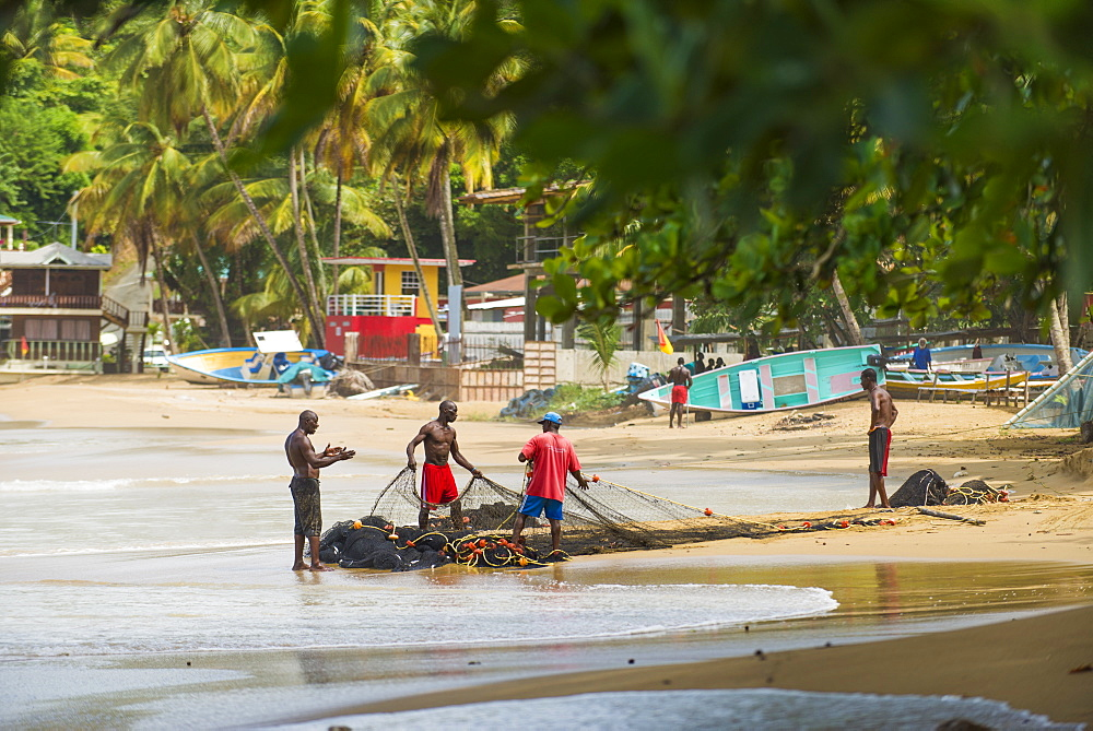 Fisherman organise their nets in Castara bay in Tobago, Trinidad and Tobago, West Indies, Caribbean, Central America