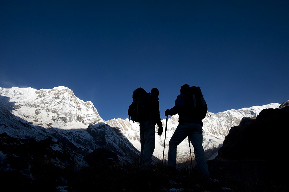 Trekkers on their way down from Annapurna base camp with views of Annapurna 1 in the distance, Himalayas, Nepal, Asia