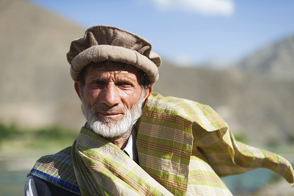 A man from the Panjshir in Afghanistan valley wearing a traditional Afghan hat