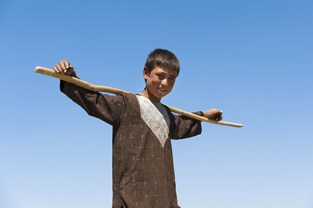 Shepherd boy takes a break in the hot sun in Bamiyan Province, Afghanistan, Asia