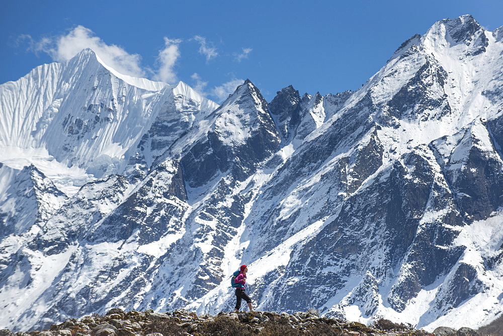 Trekking in the Langtang valley in Nepal with a view of Ganchempo in the distance