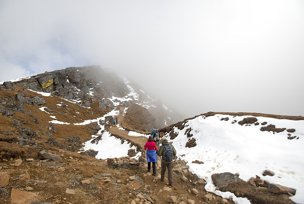 Hiking in the mist on the trail between Sian Gompa and Gosainkund in the Langtang region of Nepal.