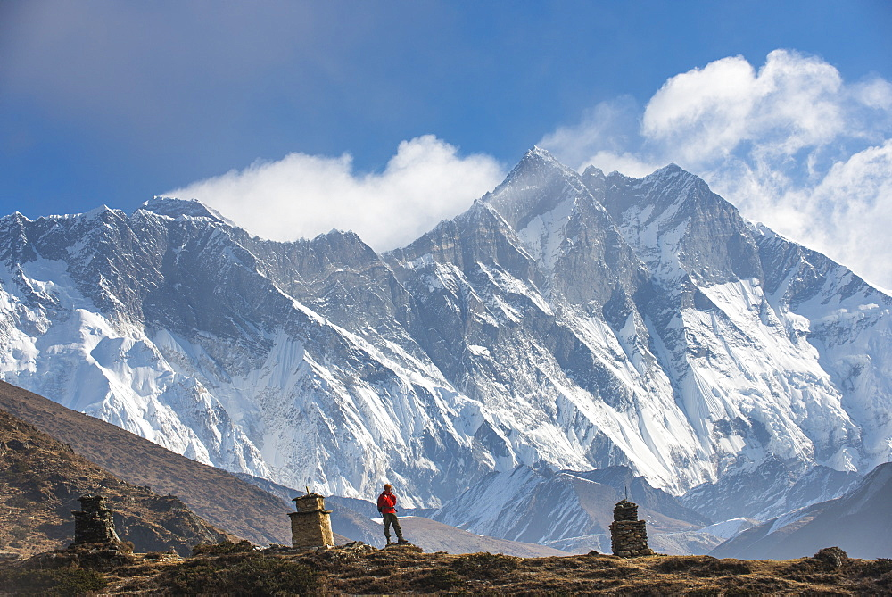 A trekker on his way to Everest Base Camp with Everest the distant peak on the left and Lhotse the peak on the right, Khumbu Region, Himalayas, Nepal, Asia