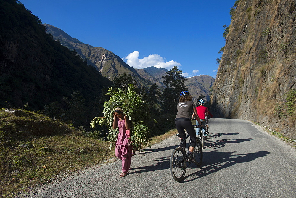 Mountain biking near the Tibetan border, Nepal, Asia