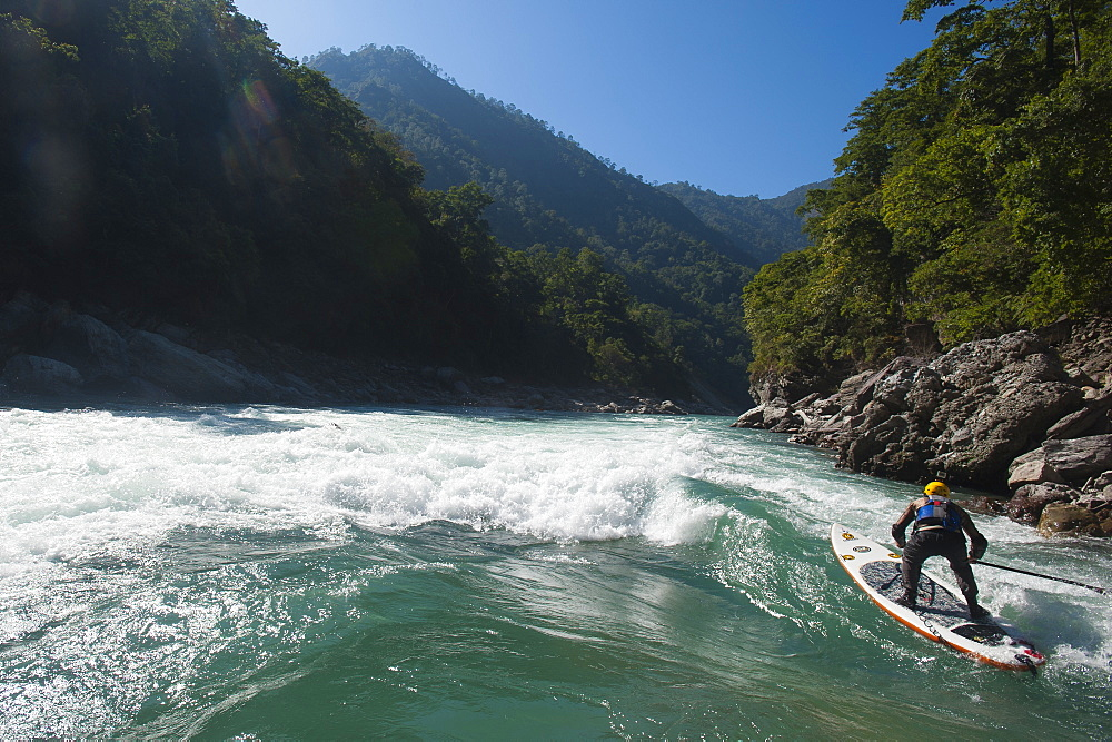 Stand Up Paddleboarding on the Karnali River, Nepal, Asia