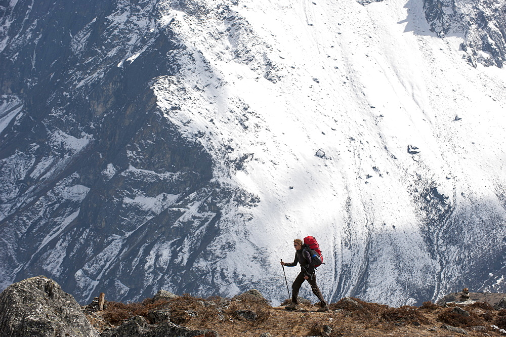 A trekker makes her way to Everest Base Camp, Khumbu Region, Himalayas, Nepal, Asia