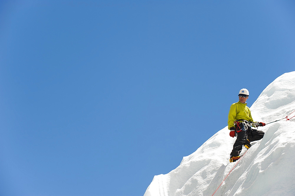A climber practises on an ice wall in preperation for climbing Everest