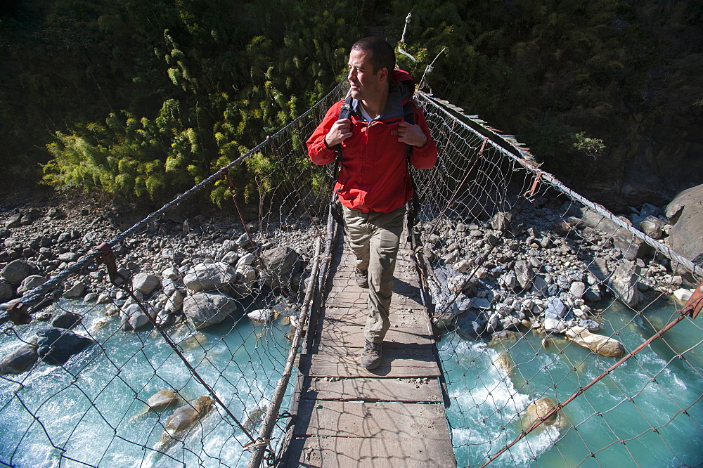 A wire suspension bridge across the Gandaki River, Manaslu Region, Nepal, Asia