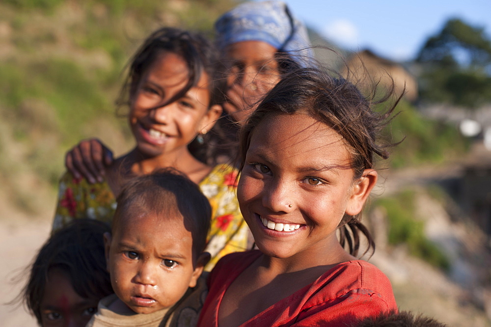 Children from a small village called Kalikot smile for the camera, Karnali District, Nepal, Asia