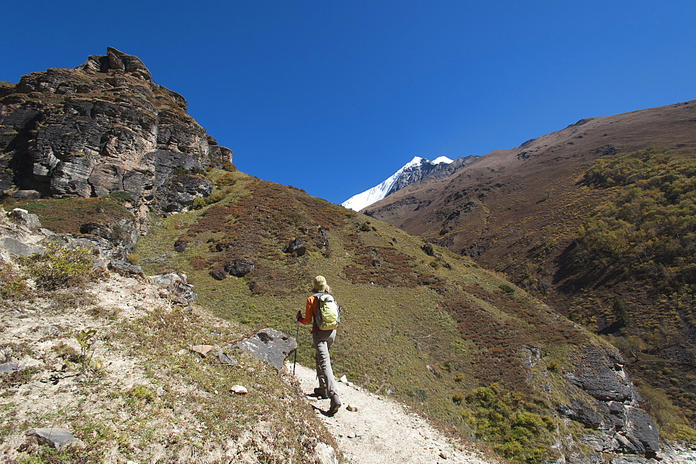 Trekking in the Kagmara Valley with the first glimpse of Lhashama in the distance, Dolpa Region, Himalayas, Nepal, Asia