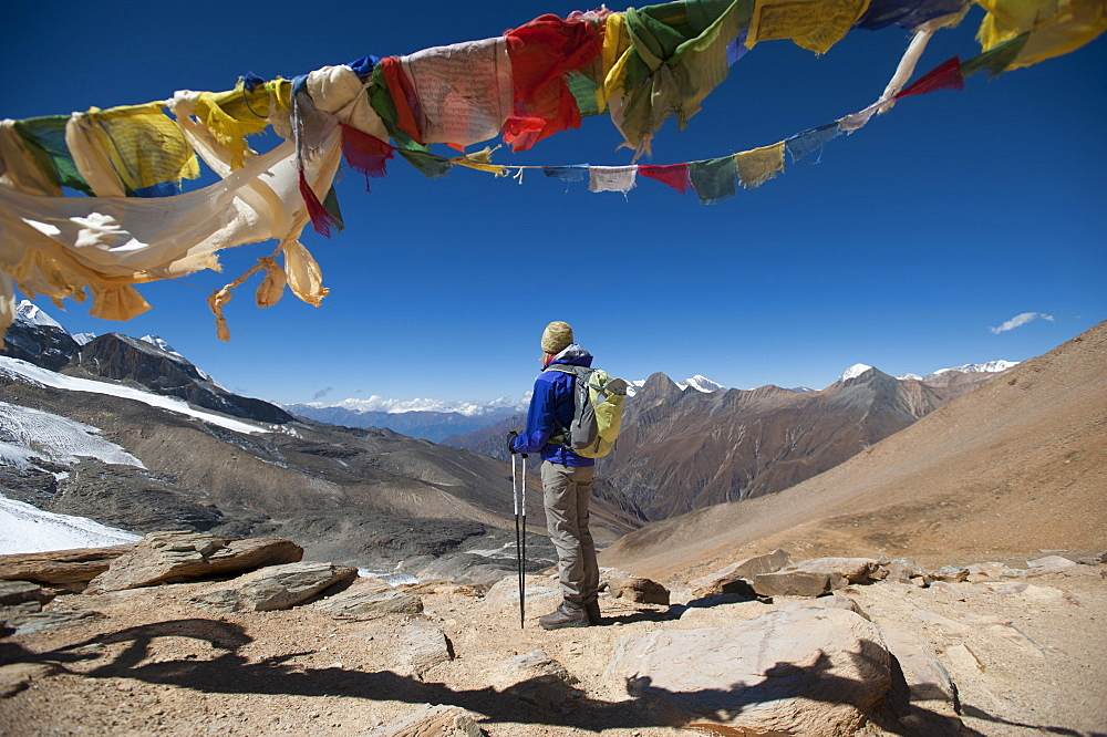 A windy prayer flag strewn cairn marks the top of the Kagmara La, the highest point in the Kagmara Valley at 5115m, Dolpa Region, Himalayas, Nepal, Asia