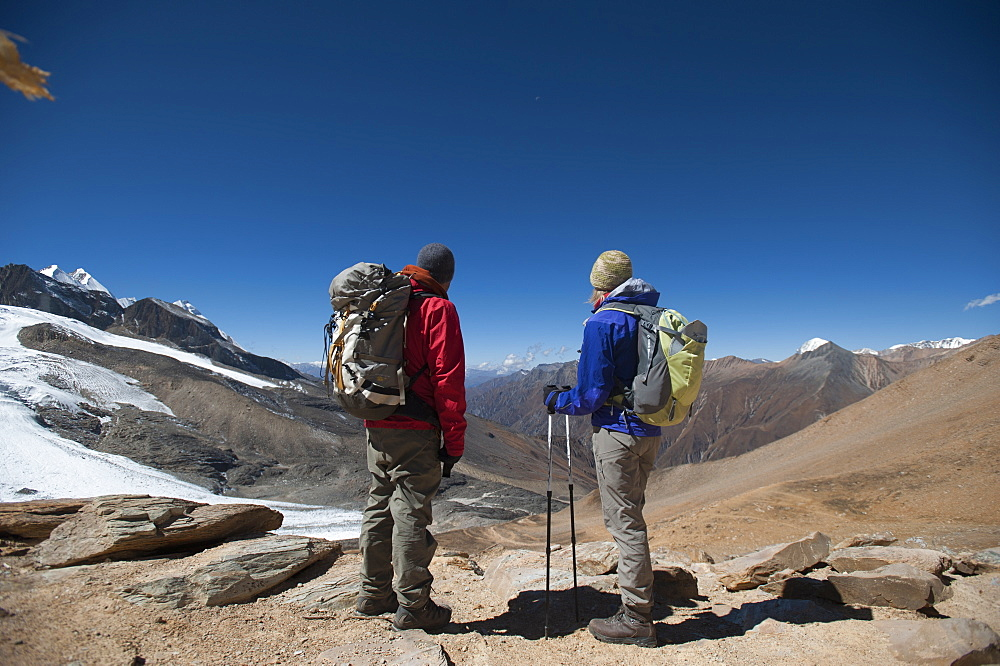 Trekkers at the top of the Kagmara La, the highest point in the Kagmara Valley at 5115m, Dolpa Region, Himalayas, Nepal, Asia
