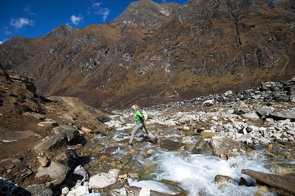 Stepping stones and stream on the trail in the Kagmara Valley, a less trodden path, Dolpa, Nepal, Asia