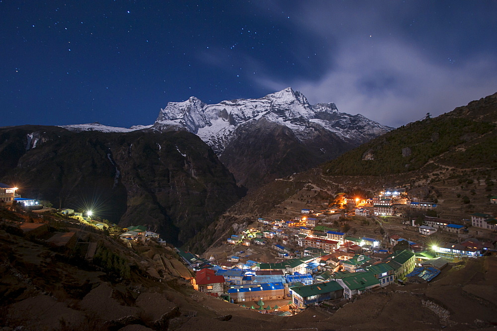 Spectacular Namche Bazaar lit up at night, in the Everest region, Himalayas, Nepal, Asia