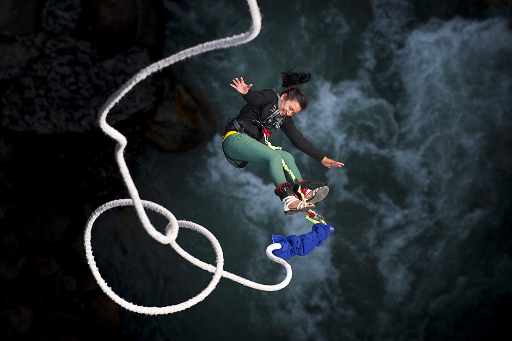 Photo of A Nepali girl bungy jumping at The Last Resort in Nepal, Asia