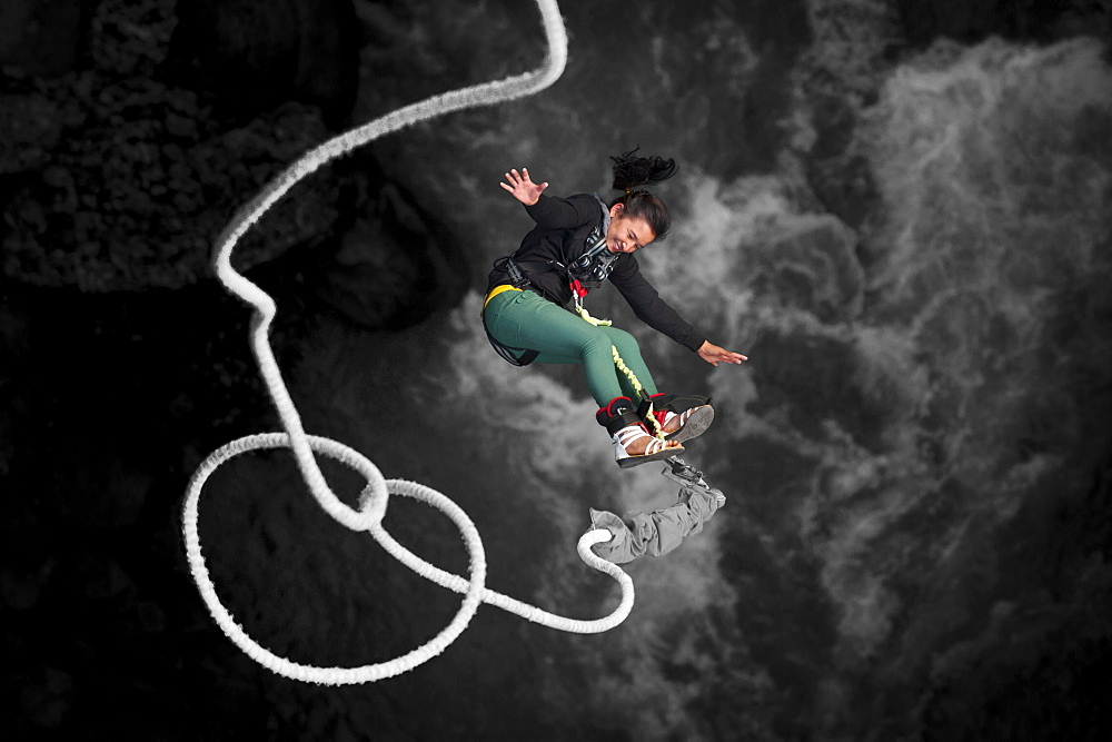 A Nepali girl bungy jumping at The Last Resort in Nepal, Asia