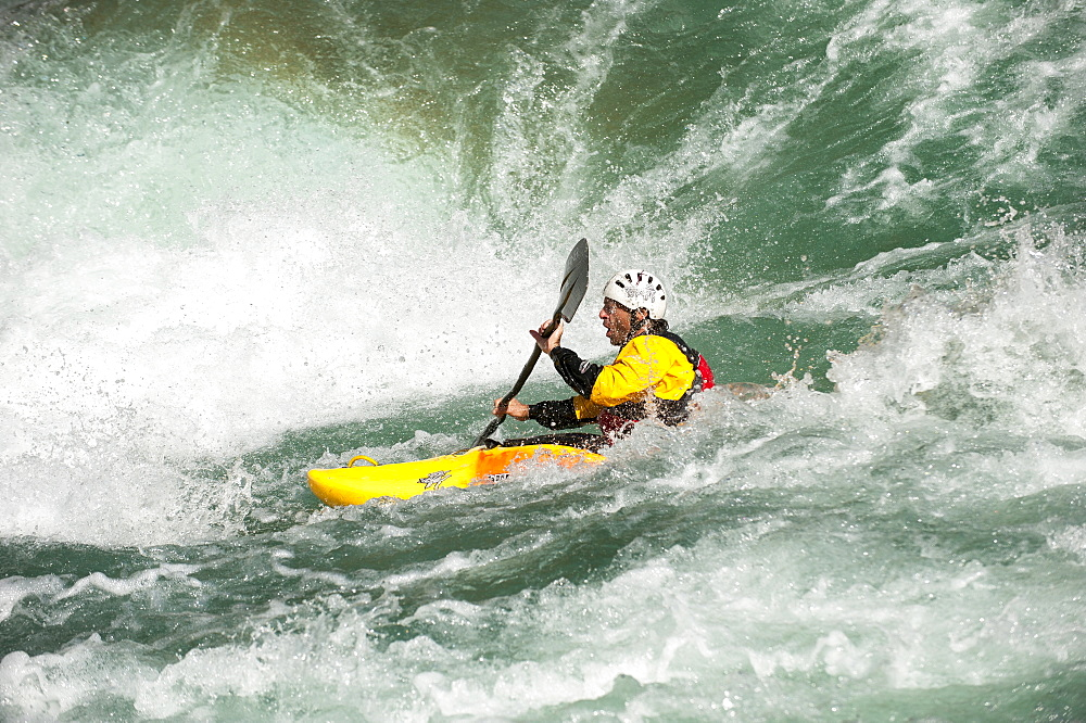 A kayaker negotiates his way through the rapids on the Karnali River, west Nepal, Asia