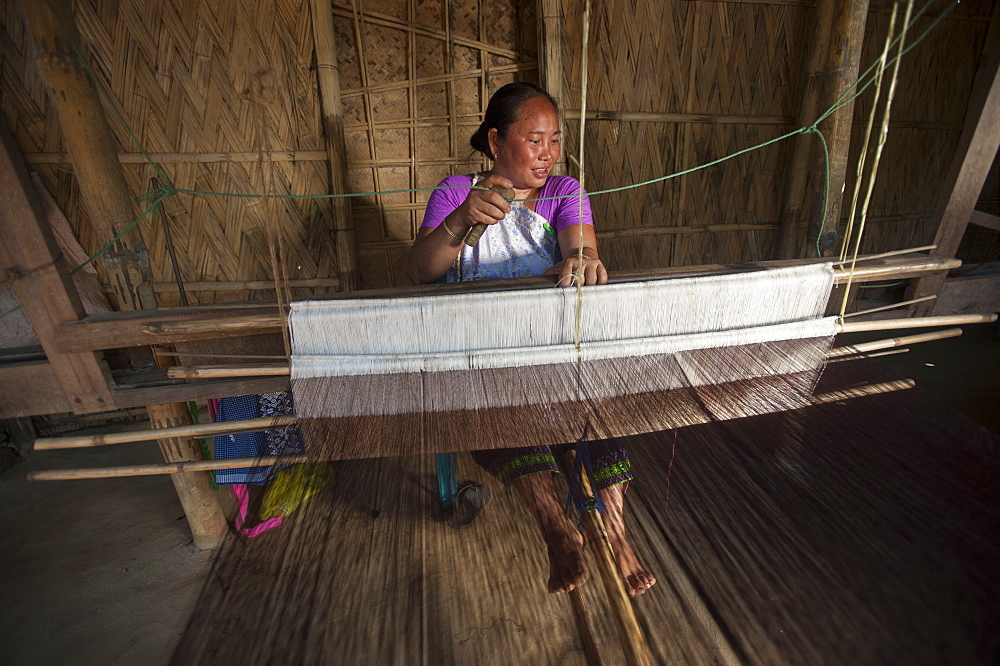 Weaving a Punin on a traditional hand loom, Assam, India, Asia