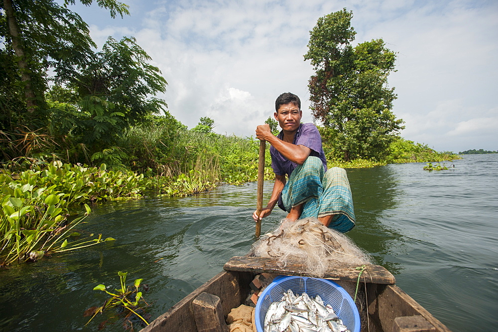 A fisherman on Kaptai lake in the Chittagong Hill Tracts in Bangladesh