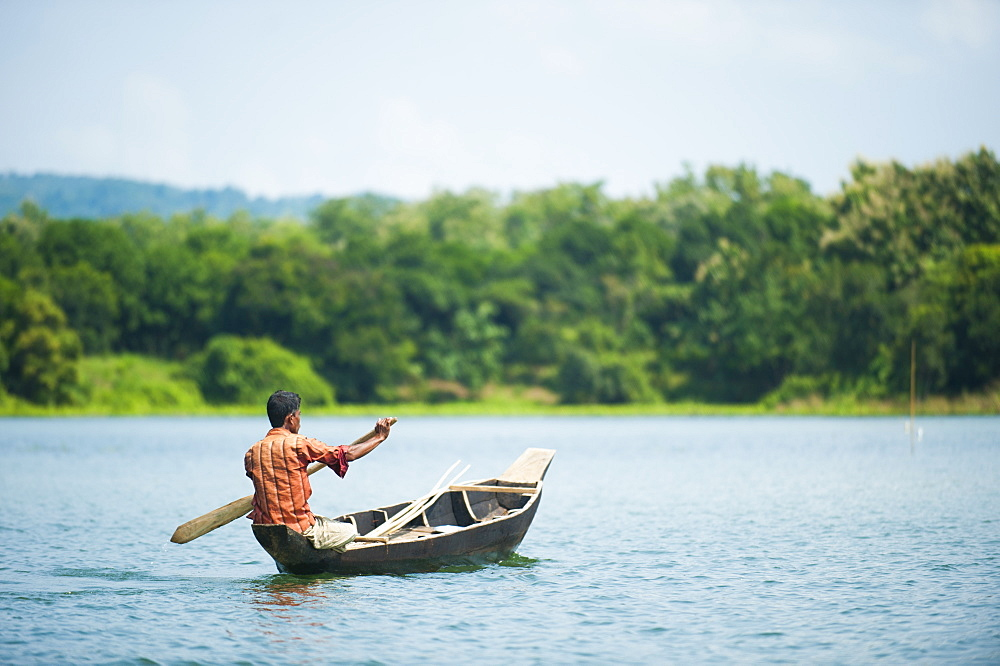 A fisherman on Kaptai Lake in the Chittagong Hill Tracts, Bangladesh, Asia