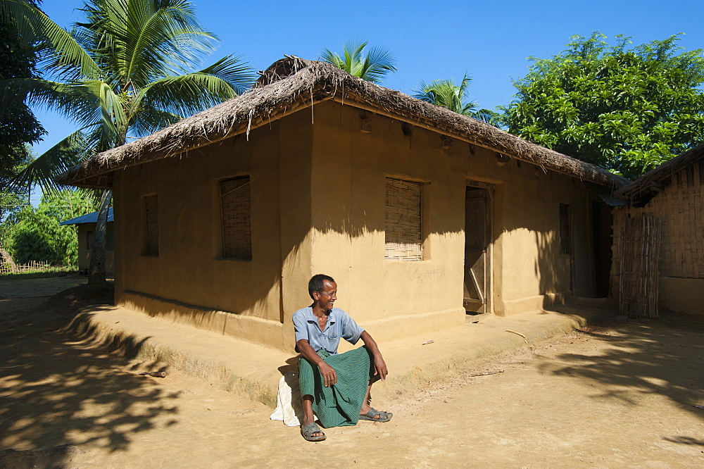 A man sitting outside his house in the Chittagong Hill Tracts, Bangladesh, Asia