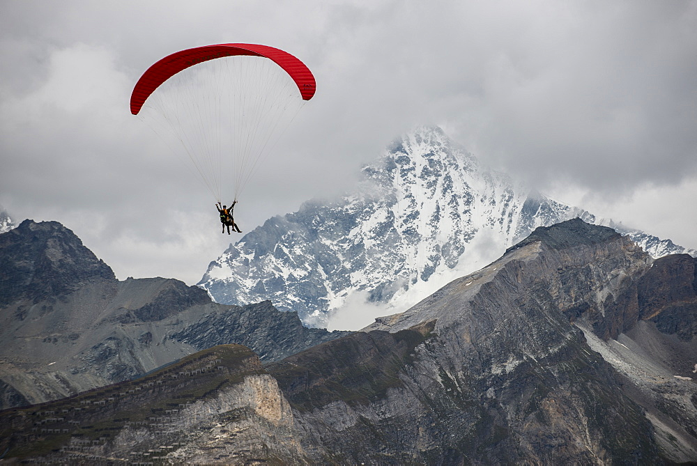 Paragliding in the Swiss Alps near Zermatt, Valais, Switzerland, Europe