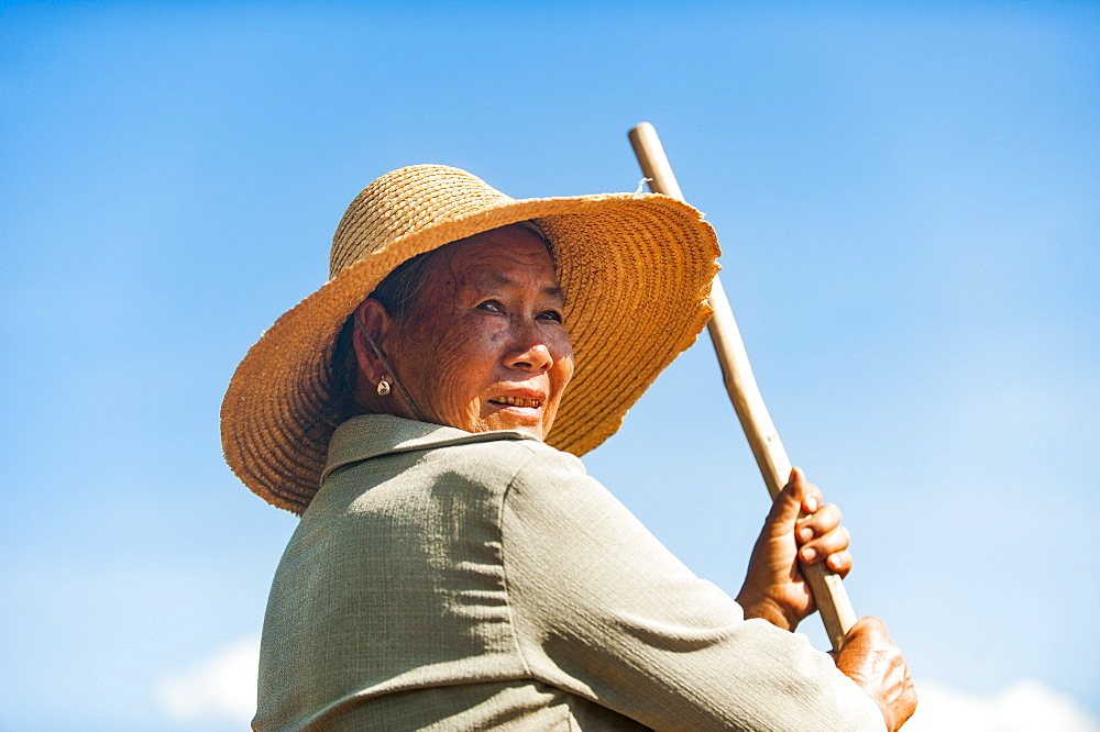 A farmer with a hand tool in Yunnan province in China