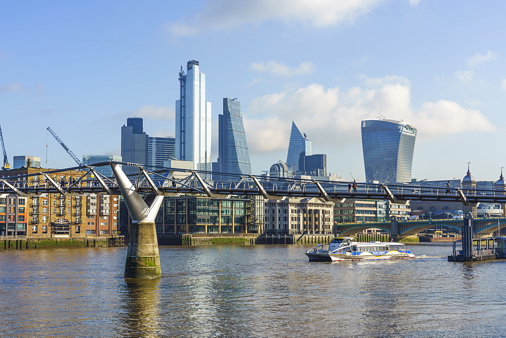 City of London skyscrapers with Millennium Bridge and River Thames, London, England, United Kingdom, Europe